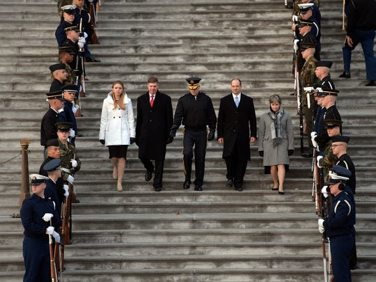 Sgt. Major Greg Lowery and Specialist Sara Corry, left, and Master Sgt. Neil Ewachiw and Master Sgt. Leigh Ann Hinton, stand-ins for President elect Donald Trump, Melania Trump, Vice President elect Mike Pence and Karen Pence walk down the East front of the Capitol steps with military escorts during dress rehearsal for the 58th Presidential Inauguration at the United States Capitol.  Mandatory Credit: Andrew P. Scott-