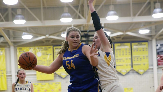 Mariemont's Rebekah Justice (54) drives to the basket against Madeira's  Jamie Grob during their basketball game last year