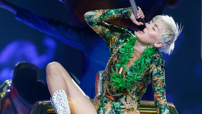 """Miley Cyrus performs at US Airways Center on the """"Bangerz"""" tour."""