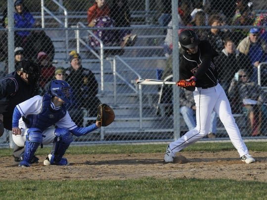 Fond du Lac's John O'Donnell takes a swing at a pitch in the seventh inning on Tuesday.