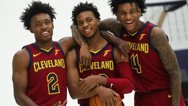 Cavs guards Collin Sexton, left,, Darius Garland, center, and Kevin Porter Jr. goof around in between photos during the Cavs' Media Day in September.