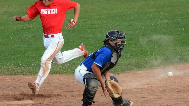 Norwich's Riley Burke scores as Waterford catcher Tate Scherer waits for the throw Wednesday during their CT Elite Baseball Association game in Norwich.