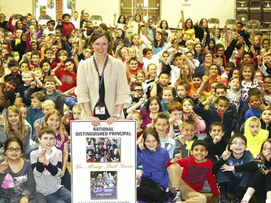 Principal Mary Beth Grove shows her award at East York Elementary School.