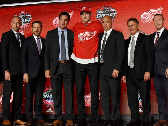 Michael Rasmussen poses for photos after being selected