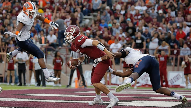 UTEP linebacker Alvin Jones forces NMSU quarterback Tyler Rogers to throw the ball away, spurring a penalty and subsequent safety last year. Rogers might not play Saturday against the Miners.