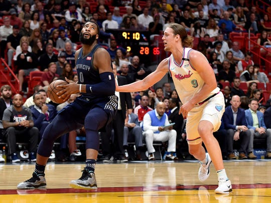Detroit Pistons center Andre Drummond (0) is guarded by Miami Heat forward Kelly Olynyk (9) during the first half at American Airlines Arena on Saturday, March 3, 2018.