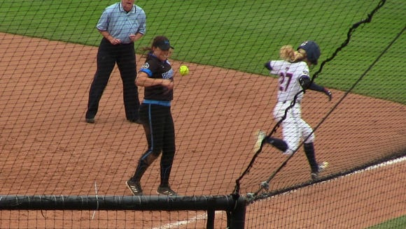 Victoria Draper beats out a throw to first base as