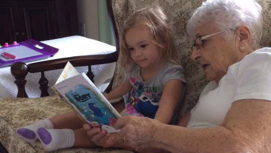 Isabella gets a reading lesson from her great-grandmother, Ann Maimone, who turns 90 on Nov. 29.