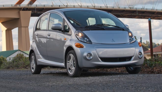 The 2014 Mitsubishi i-MiEV electric car, which got new standard equipment and a big price cut.