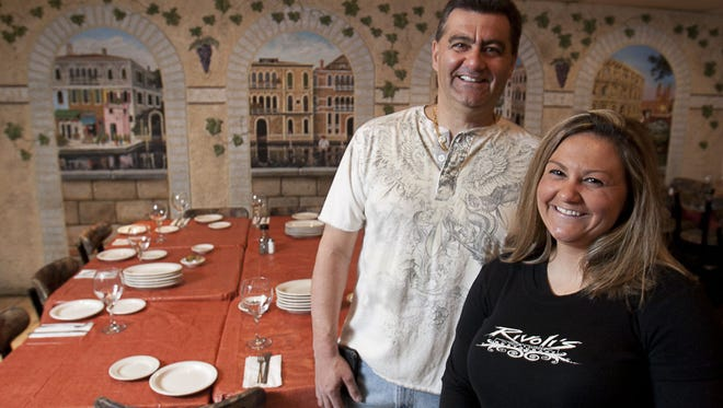 Tony Rivoli, owner of Rivoli's Italian and Seafood Restaurant, with his daughter Monica in their Toms River restaurant.