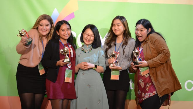 Collar Couture was third in the Asia Pacific JA Company of the Year Award. From left: Jenna Jesse Jones, Collar Couture president; Jesse Bordallo, Collar Couture production vice president; Vivian Lau, president of JA Asia Pacific; Rubeah Jung, Collar Couture finance vice president; and Ariana Felisan, Collar Couture marketing vice president.