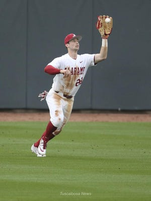 Crimson Tide right fielder Tyler Gentry hauls in a fly ball as Alabama defeated Presbyterian 7-2 on opening day at The Joe Friday, Feb. 15, 2019.