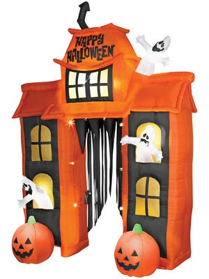 Outdoor decor creates spirited fun. Inflatable haunted house by Airblown, $149.99 at spirithalloween.com.