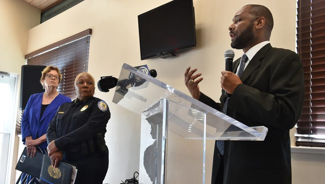 Chief Noble Wray (right), head of the COPS Office Policing Practices and Accountability Initiative with the U.S. Department of Justice, speaks alongside Fort Pierce Mayor Linda Hudson (far left) and Fort Pierce Police Chief Diane Hobley-Burney during a news conference, Thursday, Nov. 10, 2016, at the River Walk Center in Fort Pierce. The Justice Department will assist in reviewing the Fort Pierce Police Department's operations.