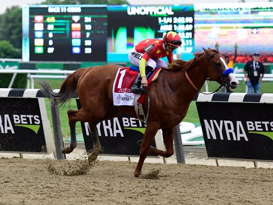 Mike Smith aboard Justify (1) wins the 150th Belmont