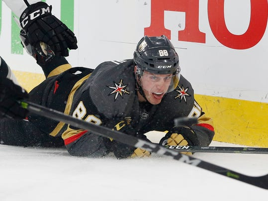 Vegas Golden Knights defenseman Nate Schmidt is knocked to the ice during the first period of Game 1 of the team's NHL hockey first-round playoff series against the Los Angeles Kings, Wednesday, April 11, 2018, in Las Vegas. (AP Photo/John Locher)