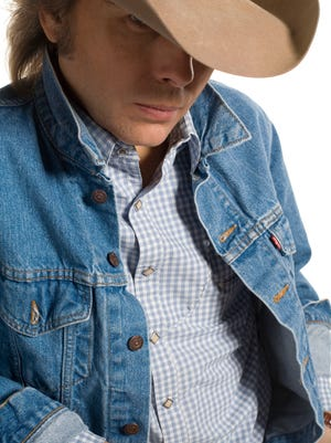 Cowpunk Renaissance man Dwight Yoakam is far from the country music mainstream and likes it that way. Catch him in concert April 7 at Memorial Auditorium.