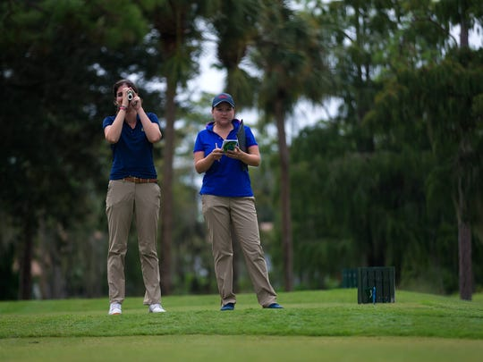 United States Golf Association Championship Manager Sarah Dusman, left, and Championship Director Rachel Sadowski survey the golf course at Quail Creek Country Club in North Naples on Thursday, Oct. 6, 2016.  Preparations have begun for the country club to host the 2017 U.S. Women's Mid-Amateur in October 2017.
