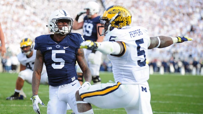 Jabrill Peppers, right, of the Michigan Wolverines reacts after a pass intended for DaeSean Hamilton of the Penn State Nittany Lions on Nov. 21, 2015, in State College, Pa.