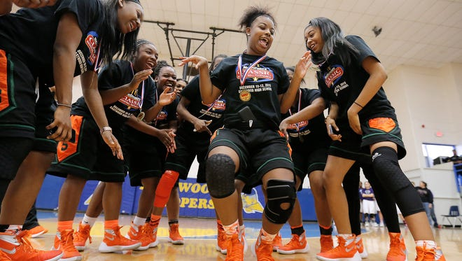 Morgan Park player Porsha Sydnor dances while surrounded by teammates after Chicago's Morgan Park High School won the girl's side of the McDonald's Classic Basketball Tournament Saturday at Eastwood High School. Morgan Park beat Eastwood to earn the title.