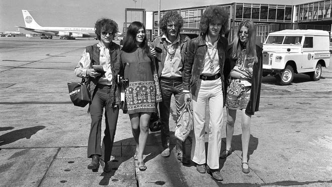 In this Aug. 20, 1967 file photo, members of the rock group Cream, from left, Jack Bruce, unidentified woman, drummer Ginger Baker, and Eric Clapton. depart from Heathrow Airport in London. Bruce, best known as the bassist from Cream, has died. He was 71. A statement released by his family announced the death Saturday, Oct. 25, 2014. Publicist Claire Singers said Bruce died at his home in Suffolk, England.