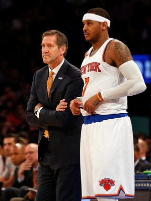 New York Knicks forward Carmelo Anthony (7) and head coach Jeff Hornacek looks on during a break in action in a recent game.