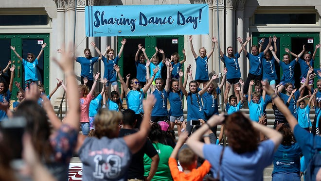 Dancers perform before a large crowd of people on the steps of City Hall at Ballet San Angelo'sinaugural Sharing Dance Day Saturday, Oct. 14, 2017.