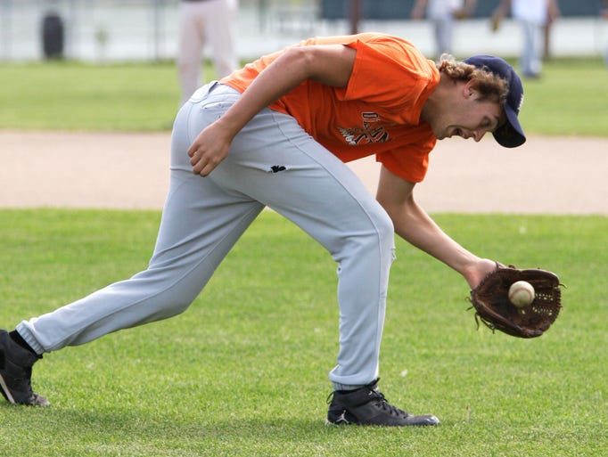 Zac Cain catches a ball during practice Wednesday July 23, 2014 at Plymouth.