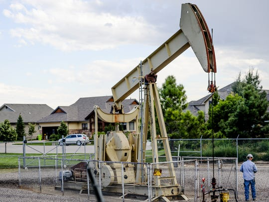An oil pump operates in the Heathfire subdivision in
