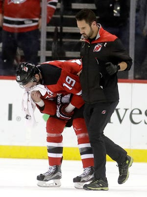 There were no lingering effects of the broken nose Devils' Travis Zajac suffered in Tuesday's 3-2 win over the Canucks when he went face first into the boards without being able to protect himself. (AP Photo/Julio Cortez)