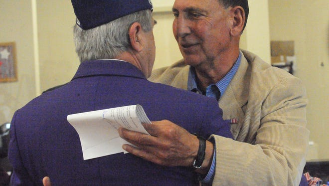 U.S. Representative Frank LoBiondo,  R-2, (right)  embraces with Purple Heart veteran  Marco Polo Smigliani during the open house and ribbon-cutting ceremony Friday afternoon for the U.S. Department of Veterans Affairs Community Based Outpatient Clinic on West Landis Avenue in Vineland.