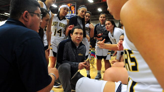 Box Elder girls' basketball coach Joel Rosette talks to his squad during a semifinal game against Belt at last season's Northern C Divisional tournament at Pacific Steel and Recycling Four Seasons Arena.