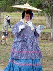 The parasol  protected the delicate skin of ladies of the 1800s.