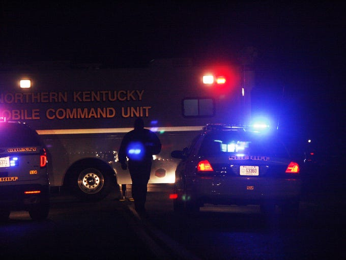 A Boone County sheriff's deputy walks toward the shooting