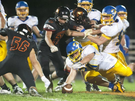 Howards Grove running back Jacob Fritz (20) recovers