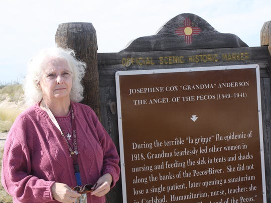 """NMSU history professor Kenda Josselet stands beside the Eddy County historical marker honoring Josephine """"Grandma"""" Cox Anderson for her work nursing flu victims in the 1918 epidemic. Josselet is a part of the state initiative that is erecting historical markers for women in New Mexico"""