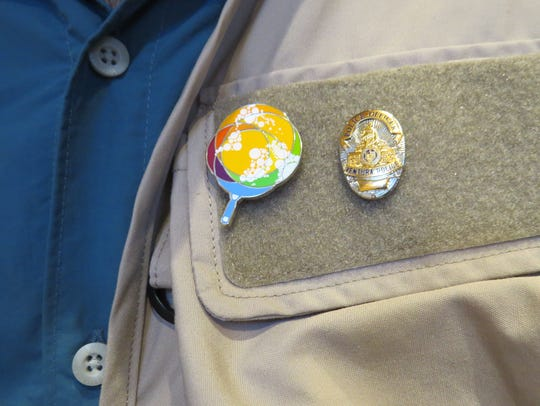 A vest worn by Jose Andres features pins depicting