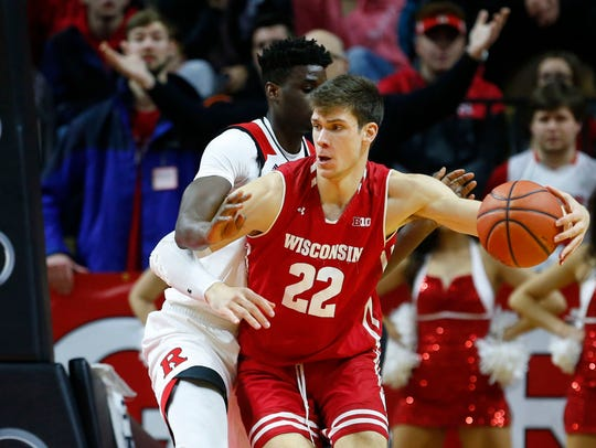 Wisconsin Badgers forward Ethan Happ (22) goes to the