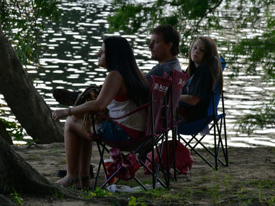 People enjoy Independence Day celebrations under the shade of trees at Gold Star Park in Wetumpka, Ala., on Friday, July 4, 2014.