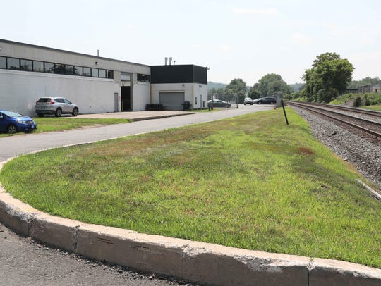 Businesses are pictured adjacent to the CSX rails,