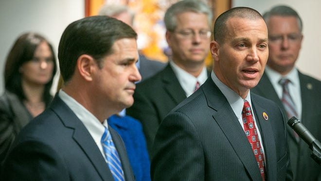 """Gov. Doug Ducey (left) gave Department of Child Safety Director Greg McKay (right) a """"clear mandate"""" to make changes at the child-welfare agency as he sees fit."""