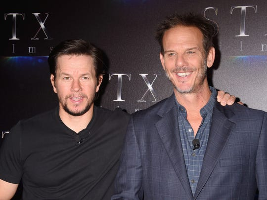 Mark Wahlberg, left, and director Peter Berg announced