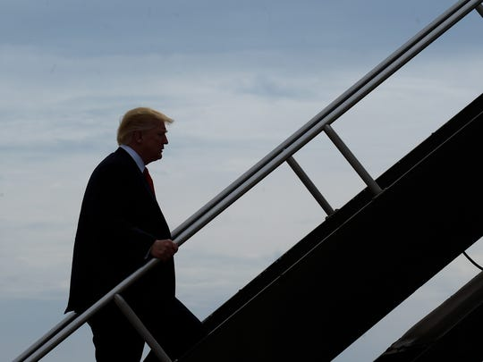 President Trump walks up the steps of Air Force One