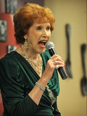 Louise Morton entertains the crowd during Friday's