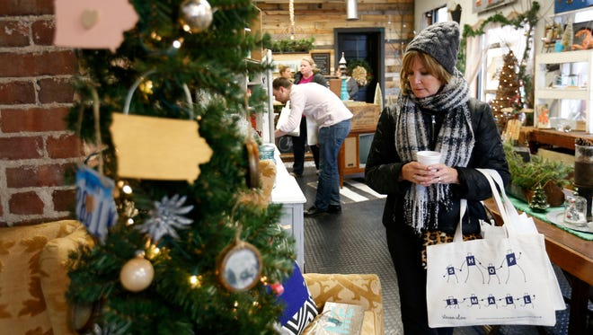 Kay Acheson of West Des Moines browses around the Finding Iowa store Saturday, Nov. 28, 2015, during Small Business Saturday in the Valley Junction shopping district in West Des Moines.