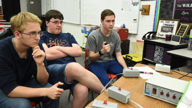 Norfork high school students Jacob Moore, from let, Bentley Branscum and Elias Maple practice on Thursday for the upcoming Quiz Bowl State Championship. The tournament, set for Saturday, will be televised on the Arkansas Educational Television Network.