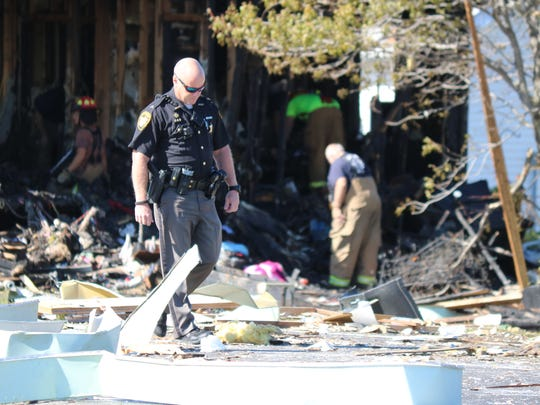 Authorities process the scene of a home explosion along East Harbor Road in Port Clinton in October 2016.