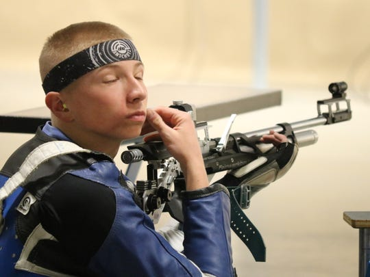 Justin Kleinhans, of the Black Swamp Junior Rifle Team, takes a moment to concentrate during the Civilian Marksmanship Program's three-position air rifle regional championships at Camp Perry on Friday.