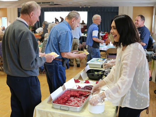 Hundreds enjoyed free meals from the Port Clinton Area Thanksgiving Feast at Trinity United Methodist Church last year.