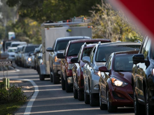 Drivers wait to exit Sanibel Island on Thursday afternoon.